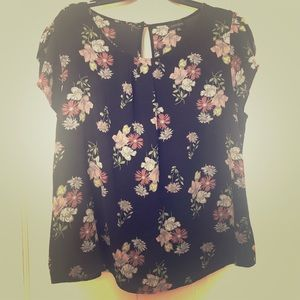 Black blouse with flowers.